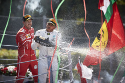Race winner Third place Lewis Hamilton, Mercedes AMG F1 Sebastian Vettel, Ferrari, pour Champagne from the podium
