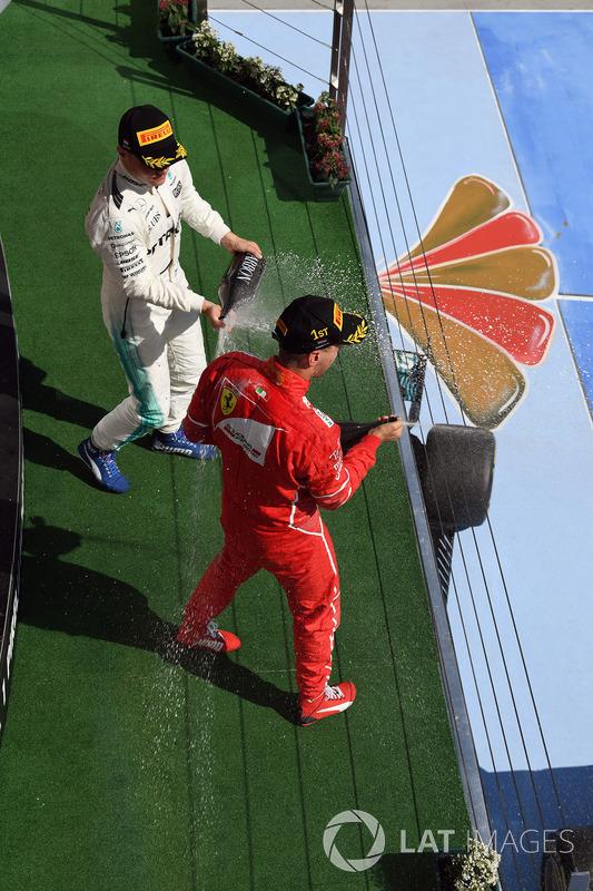 Podium: race winner Sebastian Vettel, Ferrari, third place Valtteri Bottas, Mercedes AMG F1