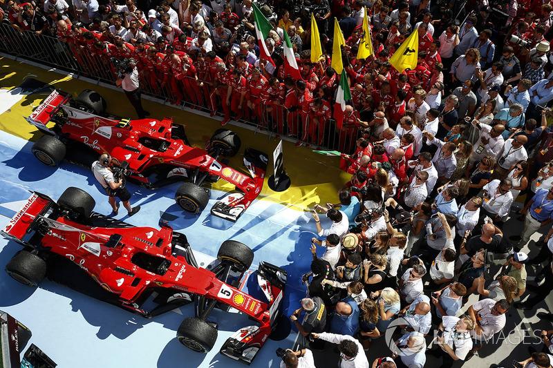 سيارة الفائز بالسباق سيباستيان فيتيل، فيراري، المركز الثاني كيمي رايكونن، فيراري