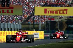 Переможець гонки Себастьян Феттель, Ferrari, друге місце Кімі Райкконен, Ferrari