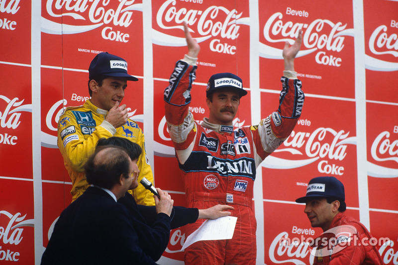 Podium : le vainqueur Nigel Mansell, Williams, le second Ayrton Senna, Team Lotus, le troisième Michele Alboreto, Ferrari