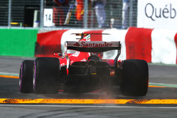 Kimi Raikkonen, Ferrari SF70H jumps the kerb