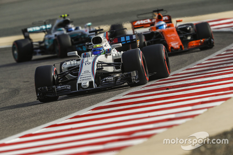 Felipe Massa, Williams FW40, leads Fernando Alonso, McLaren MCL32, and Valtteri Bottas, Mercedes AMG F1 W08