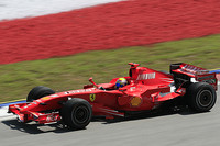 Massa claims pole position for Malaysian GP