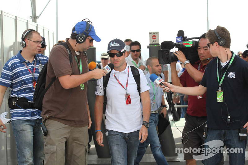 Barrichello juggling five phones to extend F1 career