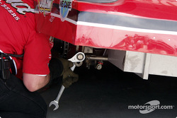 The Bud car makes a track bar adjustment