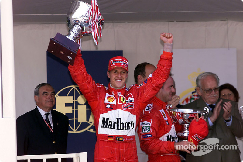 Michael Schumacher and Rubens Barrichello on the podium with the Prince Rainier