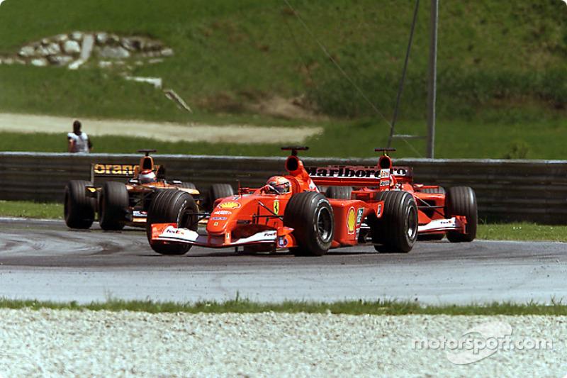Michael Schumacher and Rubens Barrichello, under pressure by Jos Verstappen