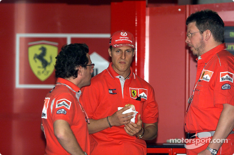 Michael Schumacher, Ross Brawn and Luca Baldisserri