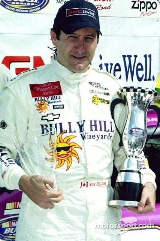 Ron Fellows hold his winning trophies
