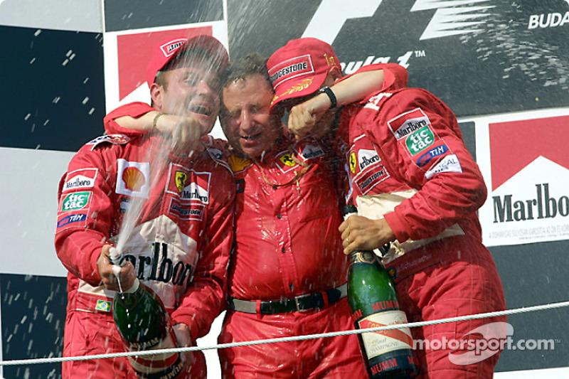 Rubens Barrichello, Jean Todt y Michael Schumacher celebrando