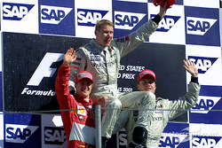 The podium: race winner Mika Hakkinen with Michael Schumacher and David Coulthard