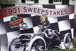 Two year old Thomas Brefeld Jr. has his picture taken as Henry Ford, racing the 1901 Sweepstakes race while enjoying the day