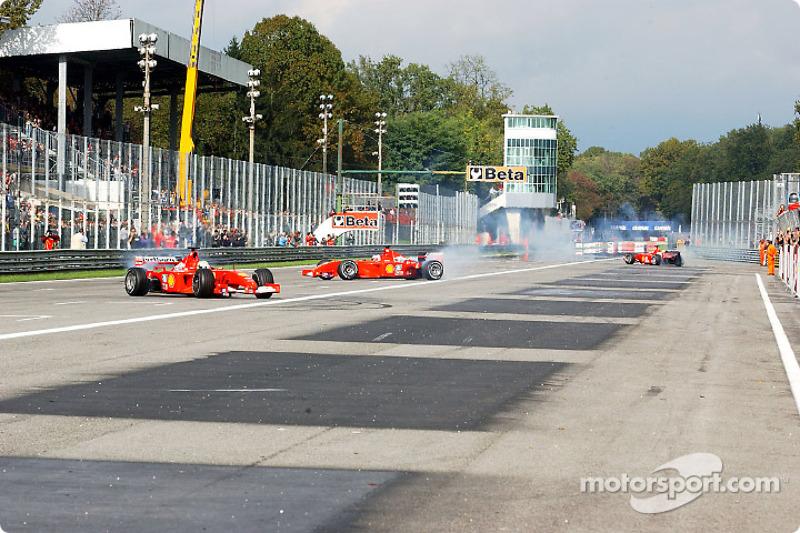 Michael Schumacher, Rubens Barrichello and Luca Badoer going crazy