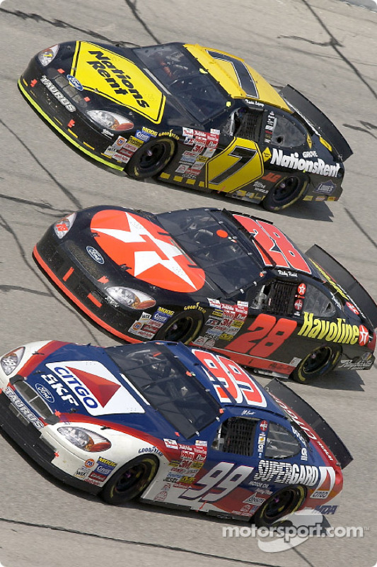 Traditional three wide racing at Talladega as Jeff Burton, Ricky Rudd and Kevin Lepage are battling it out in turn four