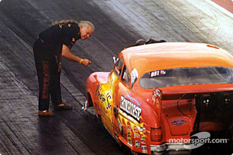 Team owner Johnny Rocca helps Paul Athey stage