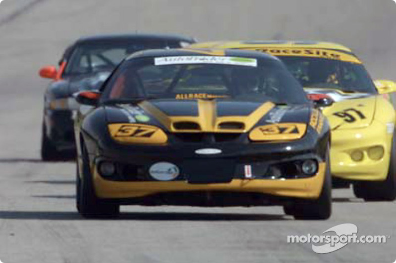 One of Phoenix American Motorsports cars races down a straightaway
