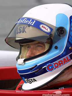 Dallara driver Mauro Baldi sits in his car at Daytona during Saturday's Grand-Am testing