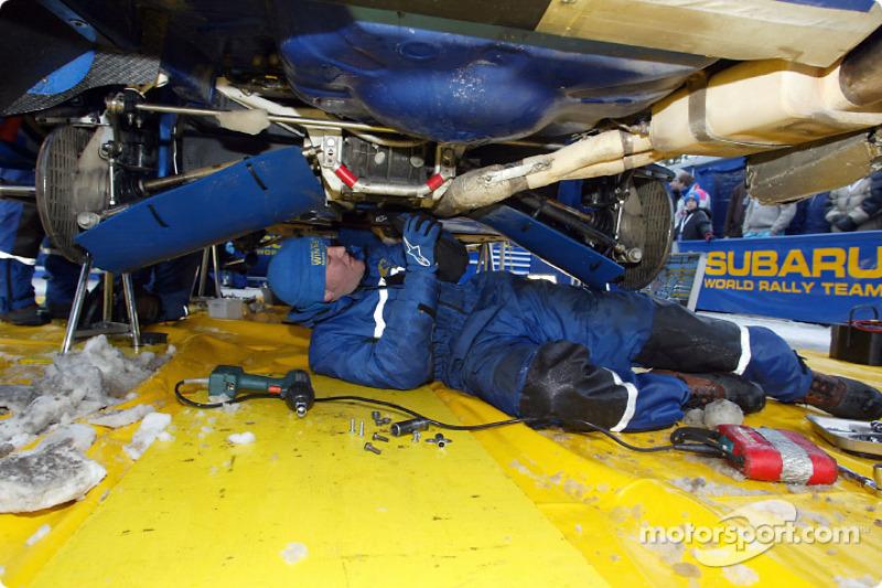 The SWRT mechanics service one of the teams Impreza WRC