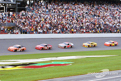 Tony Stewart leading Dale Earnhardt Jr. and the field