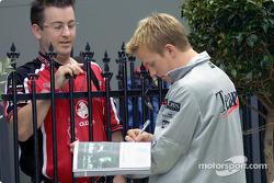 Kimi Raikkonen signing an autograph