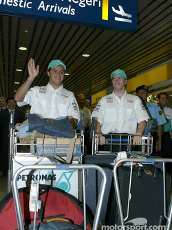 Felipe Massa and Nick Heidfeld at the airport
