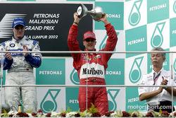 Ralf and Michael Schumacher on the podium