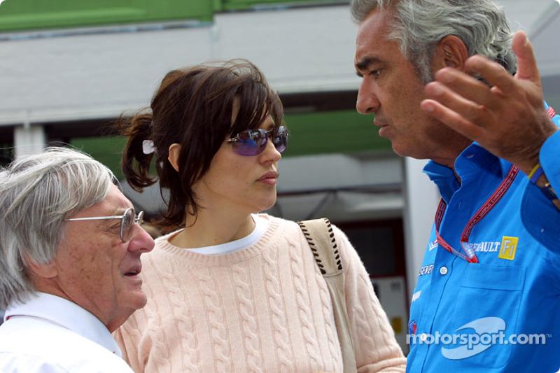Bernie and Slavica Ecclestone discussing with Flavio Briatore