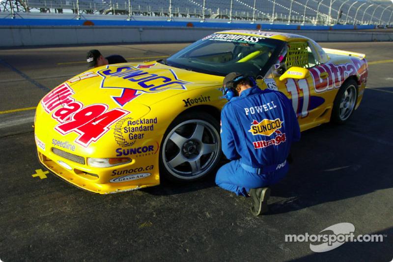 A crew member checks the tire of Powell Motorsports' #11 Corvette during Thursday's practice at Phoenix International Raceway