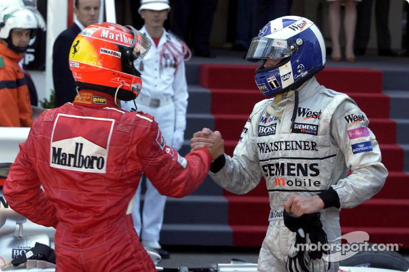 Michael Schumacher congratulating race winner David Coulthard