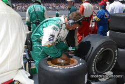 Team Green crew member checking tires