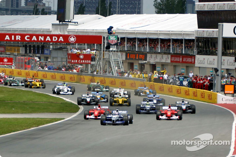 The start: Juan Pablo Montoya leading Rubens Barrichello and Michael Schumacher