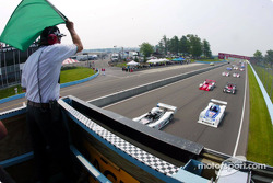 The green flag waves to start the 6 Hours of The Glen