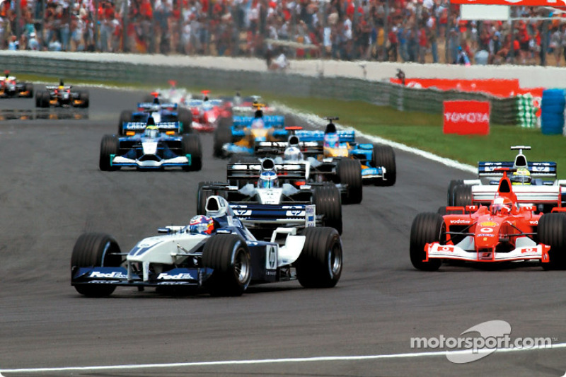 The start: Juan Pablo Montoya leading Michael Schumacher