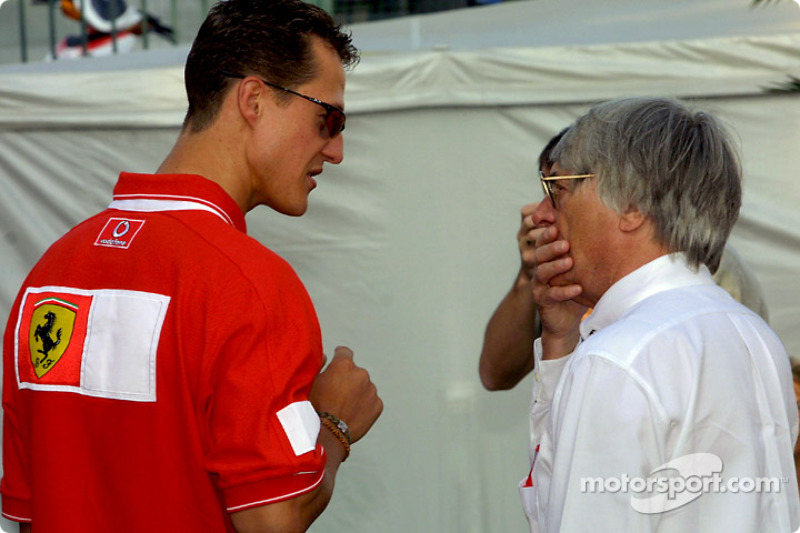 Michael Schumacher discussing with Bernie Ecclestone