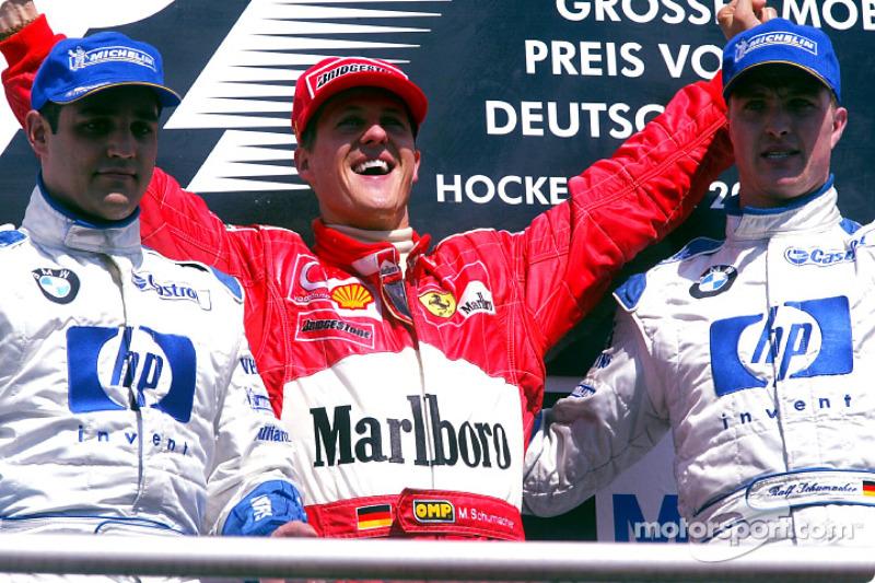 The podium: race winner Michael Schumacher with Juan Pablo Montoya and Ralf Schumacher