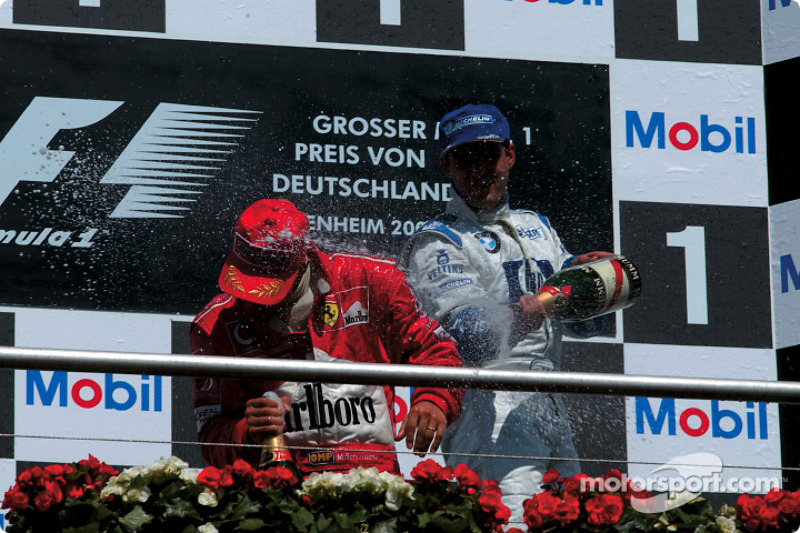 The podium: champagne for Michael Schumacher and Juan Pablo Montoya