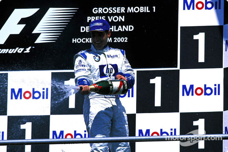 The podium: champagne for Juan Pablo Montoya