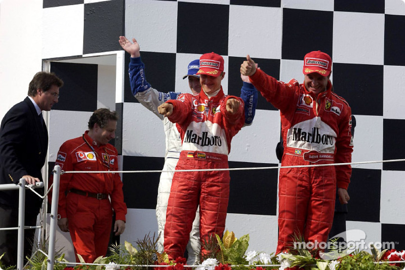 The podium: race winner Rubens Barrichello with Michael Schumacher and Ralf Schumacher