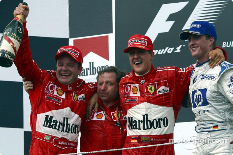 El podio: el ganador de la carrera, Rubens Barrichello con Jean Todt, Michael Schumacher y Ralf Schumacher