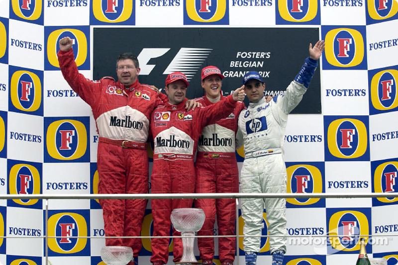 The podium: race winner Michael Schumacher with Ross Brawn, Rubens Barrichello and Juan Pablo Montoy