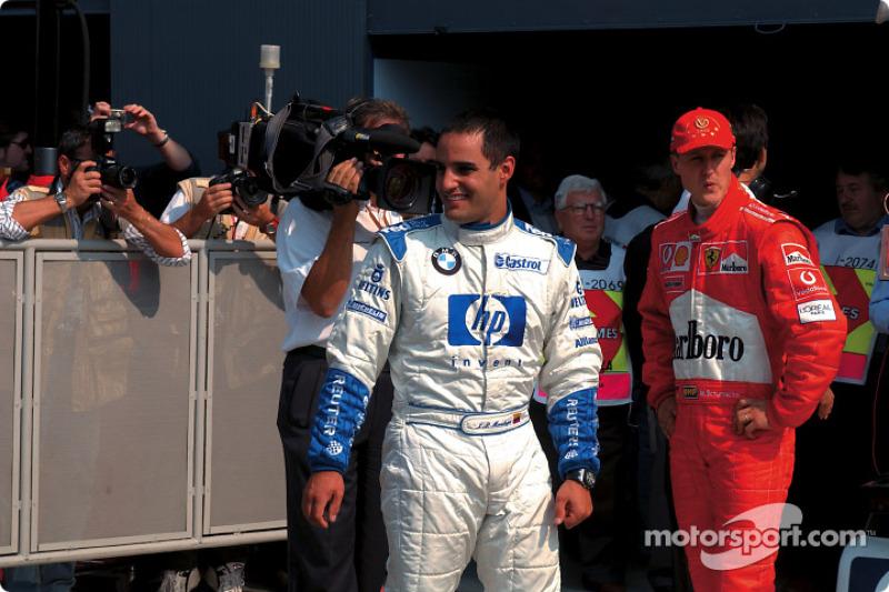 El ganador de la pole, Juan Pablo Montoya y Michael Schumacher