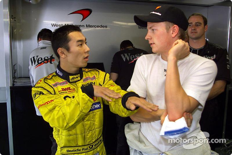 Takuma Sato and Kimi Raikkonen discussing accident