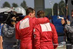 Race winner Rubens Barrichello and Michael Schumacher