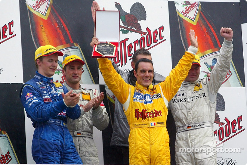 The podium: Mattias Ekström, race winner Bernd Schneider, DTM champion Laurent Aiello and Uwe Alzen
