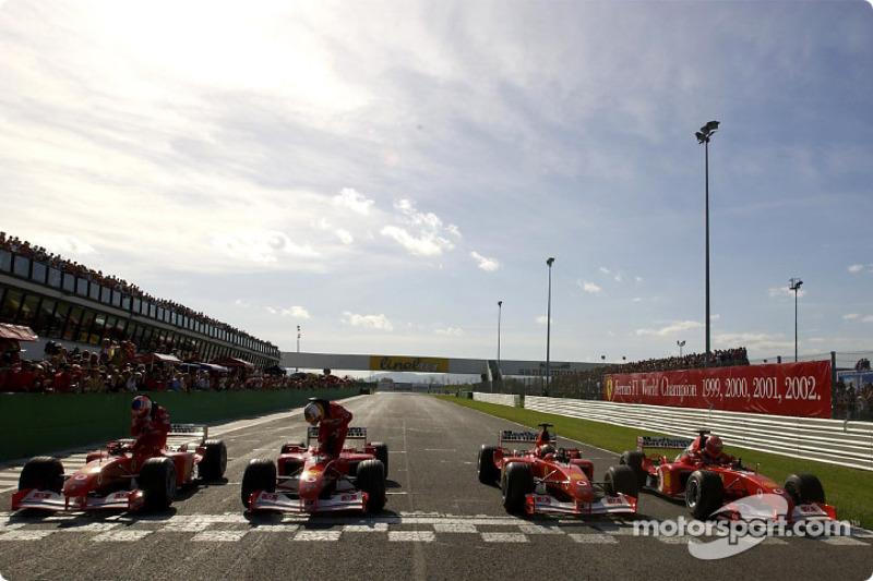 Four Ferrari F2002 on the track: Rubens Barrichello, Luca Badoer, Luciano Burti and Michael Schumach