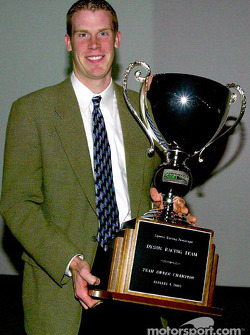 Salute to 2002 champions: Chris Dyson receives the Champion SRP team owner trophy