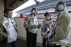Anthony Davidson talks with Geoff Willis while Takuma Sato looks on