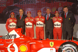 Paolo Martinelli, Rory Byrne, Ross Brawn, Felipe Massa, Luca Badoer, Michael Schumacher and Rubens Barrichello with the new Ferrari F2003-GA