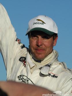 Race winner Scott Pruett celebrates